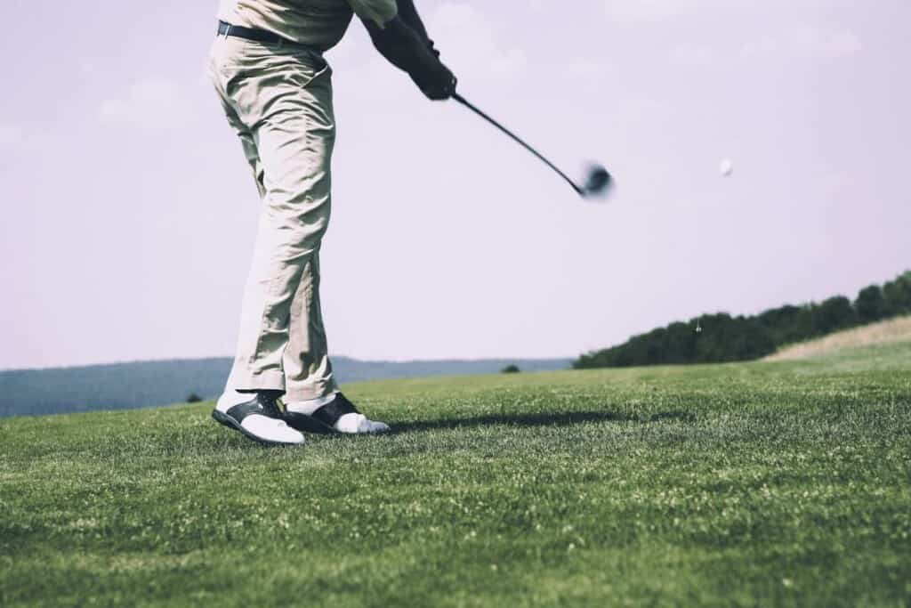 Top things to Do in Door County, WI, A men Playing golf in  golf course