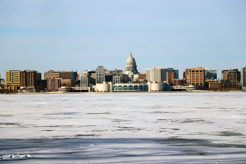 places to visit in wisconsin in winter, Madison winter cityscape with frozen lake Monona on a foreground during cold sunny day. Midwest USA, Wisconsin.
