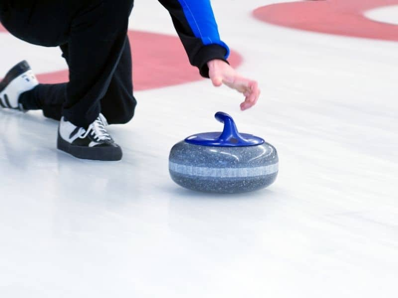 ice curling in green bay, wisconsin in winter