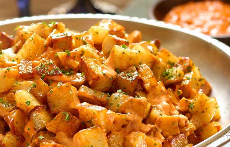 typical Food from Barcelona and Catalunya in Spain, Patatas Bravas dish